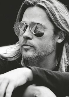Brad Pitt wearing polarized aviator sunglasses.  Shop Similar styles at Emblem Eyewear