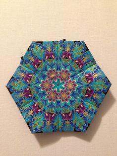 """Katja Marek's The New Hexagon - Millefiore Quilt-Along: Rosette 1: """"block 9 - Doris"""" -- completed by Tracy Pierceall, 1/1/2015 (fabric is Timeless Treasures """"Dynasty"""")"""