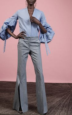 The designer: Minimalist-lover Sylvie Millstein embodies her brand and has mastered the appeal of clean, simple lines. This season it's about: Exaggerated silhouettes in strong colors and prints. The piece to buy: The blue balloon-sleeved blouse that redefines suiting.