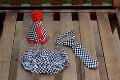 Great idea for cool 1st birthday photos: matching party hat, tie or necklace(s), diaper cover! This idea adapts easily to any theme.