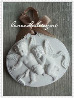 gessetto ovale con angeli bomboniera battesimo comunione cresima