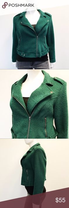 """Torrid Forest Green Moto Jacket Beautiful forest green cropped Moto jacket from torrid! Brocade textured fabric. Asymmetrical zipper. Attached snap on belt. Two functional zippered front pockets. Military style epaulets on the shoulder. Fully lined. New with tags, never worn. Undamaged. Smoke and pet free home. Measurements taken laid flat. 23"""" armpit to armpit. 22"""" natural waist. 23.5"""" long shoulder to hem. 25"""" long sleeves. torrid Jackets & Coats"""