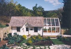 so want this. cute little cottage/cabin with greenhouse attached