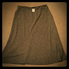 Beautiful Salt and Pepper look!! Salt and pepper toned skirt. With a beautiful flare...good for a twirl or two??...very tummy flattering. A little too long for me..I'm 5'4 and it covers me toes and I don't want to ruin it by trampling on it. Needs a styling diva to take over!! Christopher & Banks Skirts