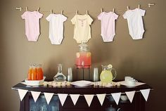 "Baby shower - I like this idea with the clothes line. Those little onesies are pretty cheap to buy too and then she can keep the ""decorations"". I like the lemonade stuff and the bunting."