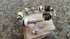 Gold and black 2 tone viking knit bee charm bracelet
