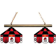"""Stylish, hand-crafted stained glass Georgia Bulldogs Executive 2 Shade Game Lamp.  Great for the game room or rec room.  Two full shades feature multi-colored glass in team colors with team logo design on alternating glass panels.  Each shade measures 14""""H x 14""""D.  Brass support bar measures 34""""L.  This light is direct wire (no wall plug) and comes with canopy kit.  Made in the USA."""
