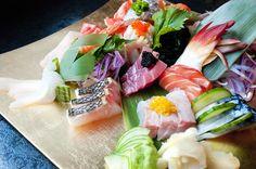 SASHIMI APPETIZER. Three cuts each of tuna, salmon, yellowtail, served with grated wasabi.