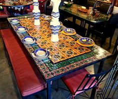 Mexican Tile Tabletops Use of Mexican Tiles is not limited to walls and floors. Tiles from Mexico can be used for decorating furniture including tabletops and seats. There are two ways of creating mosaic decor. Either yo… Mosaic Patio Table, Round Patio Table, Mosaic Coffee Table, Patio Tables, Glass Dining Room Table, Dining Table Design, Dining Tables, Dining Rooms, Kitchen Dining