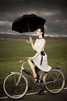 What can I say? This woman comes dressed for the sunshine, & prepared for the rain! :-)