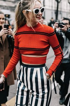 I like this orange coloured top combined with a dark blue and white vertival striped palazzo pants