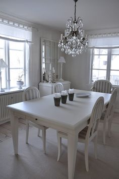 Dining Room- I like this normal sized room, windows and crown molding are gorgeous! -Must have have separated a formal dining room in my house!