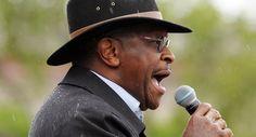 Herman Cain is shown speaking in Minnesota in April. | AP Photo. Herman Cain, Bidness man.