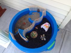 Found a tiny baby box turtle in the yard, so we repurposed a water table the boys have grown out of into a turtle habitat. I planted grass seed and lettuce/spinach mix in the potting soil :)