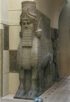 "Lamassu (winged, human-headed bull), from the citadel of Sargon II, Dur Sharrukin (modern Khorsabad), Iraq, ca. 720–705 BCE. Limestone, approx. 13' 10"" high. Louvre, Paris    Winged, man-headed bulls designed to ward off enemies and evil spirits  Partly in the round, one side against the wall, high reliefs on adjacent corners  The front view of the animal is at rest with the side views in motion  Each has five legs  The approach is conceptual rather than optical in nature"