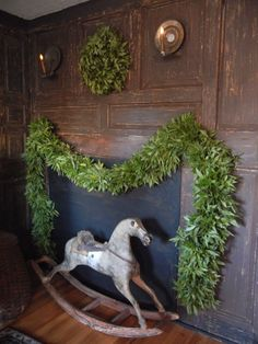Simple, perfect fireplace decor with fresh wreath and garland.