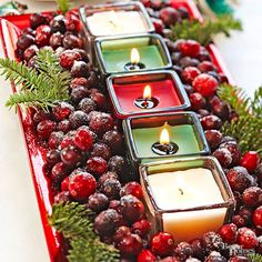 This stunning Christmas centerpiece is surprisingly simple to put together. Line a rectangular tray with red, green, and cream votive candles. Complete the look with fresh cranberries dusted with sanding sugar along with touches of greenery./
