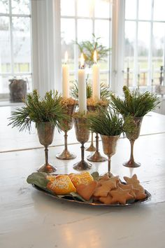 PINE GREENERY and CANDLES IN GOBLETS.  must be on the lookout for vintage goblets...