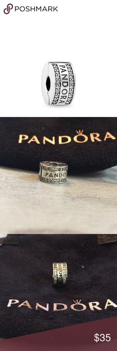 NWOT pandora logo clear sterling silver CZ clip 100% authentic. NWOT , never used. Two lines of sparkling stones, the pandora logo and an innovative silicone grip, makes this sterling silver clip a must have for your bracelet!  Comes in a pandora suede pouch  ONLY reasonable offers will be considered. Pandora Jewelry