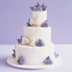 Embossed fondant with bows and beautiful sugar lilacs. I love the traditional shape offset.