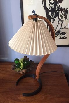 A personal favorite from my Etsy shop https://www.etsy.com/listing/511394079/mid-century-bentwood-and-iron-base