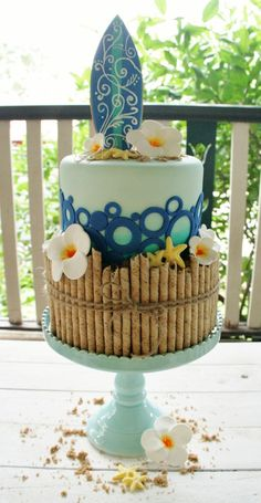 Surf themed cake.  Like the pouralines for the bamboo fencing.  also the waves are funky