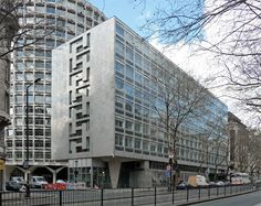 """45-59 Kingsway, by Richard Seifert & Partners, 1964-68, and of a piece with Space House behind.This block fronts Kingsway and is """"perfectly harmless except for the heavyweight antics of the Kemble Street corner"""". The abstract geometric pattern is typical of the 1960s, and the tapering pilotis are typical of Seifert. Both buildings are currently occupied by the Civil Aviation Authority and hence the former is also known as CAA House."""