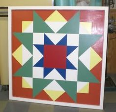 half size barn quilt with raised frame around it.  Nice colors.