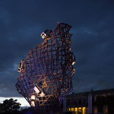 Designer Gerry Judah attached Land Rovers to a 34-metre high steel framework at the Goodwood Festival of Speed in England