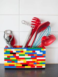 A box made of colorful plastic blocks to hold stuff. Needs a particular kind of decor, but could be cute.