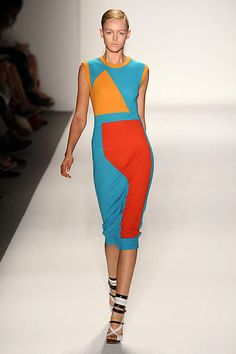 This dress exemplifies a Split Complementary colour scheme because if observed on a colour wheel it forms a triangle from blue as the main colour and red and orange as the other two colours incorporated.