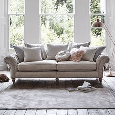 The Craven Grand Sofa is an understated classic that will add a touch of grandeur to your lounge. it features chic scrolling arms and a comfy cushion back.