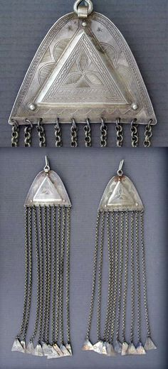 Africa | Extemely rare matching pair of silver chased Tuareg temple decorations, from South Algeria or Niger | ca. early to mid 20th century.  Most of the small triangular dangles are more recent, replacing the old missing ones | 590$
