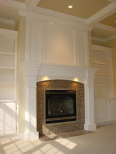 McKee Drabik looks like your built-ins.this could be the solution for the space above your fireplace (paint wall white, then add decorative trim to resemble molding) Fireplace Redo, Fireplace Built Ins, Fireplace Remodel, Fireplace Surrounds, Fireplace Design, Fireplace Mantels, Mantles, Fireplace Trim, Fireplaces