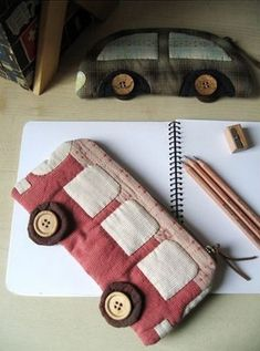 photo a pencil case for school with their hands in the form of cars
