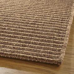 2x3 Shades of brown and sand weave a neutral rug that's stain and soil resistant.