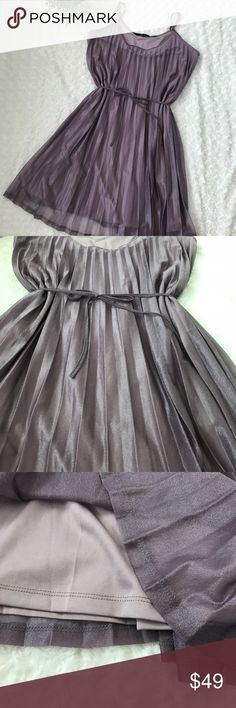 💟 VERO MODA PURPLE DRESS 💟 💟 VERO MODA PURPLE DRESS 💟 Size XL. Like new condition. GORGEOUS LILAC PLEATED SHIFT DRESS! Vero moda brand. Amazing quality. Pleated material with a beautiful shimmer to it (please see pics) perfect for a wedding, summer vacation, or just lunch with friends! Dress it up or dress it down! Adjustable spaghetti straps. A couple Minor runs but couldn't get them to show up in pics and with pleats they don't show at all ☺️ Measurements approximate  Pit to pit 21…