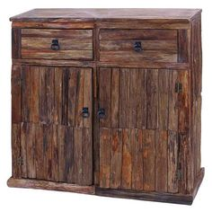 Showcasing a weathered wood frame and textured detailing, this rustic cabinet is perfect for stowing entryway essentials or books and magazines in your livin...