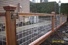 Interesting idea. Hog panels framed with wood to be a nice yard fence.  (I think I'd also spray paint it black, though)