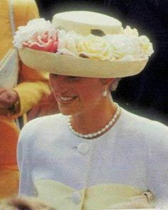 Diana wearing a white wide brim hat with carnations at Royal Ascot in 1991