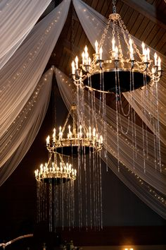 These chandlers are so beautiful. Beads hanging from chandeliers.