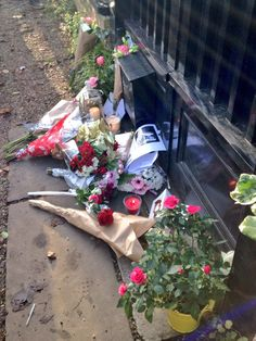 Flowers left by fans outside of George Michael's English Cottage Jem