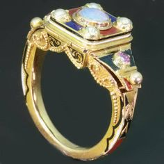 a poison ring with three different hidden sections. We can only wonder what they were used for..... We let the pictures speak for themselves.   A poison ring is a type of finger ring having a hinged bezel that conceals a compartment said to have held in poison. Although no such use has been factually established, there are historical (e.g. Hannibal's death) and literary references to such rings. It has been surmised that the compartment may usually have contained perfume or a relic. # 1
