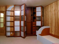 Modern Wooden Wardrobe Designs For Bedroom Modern Architecture   Home Design Furniture Storage Excellent 4 Folding Door Wardrobe Closet With White Lite And Frosted Glass Door As Inspiring Buil In Wardrobe Closet Cabinetry In Small Space Bedroom With Wooden Wall Panelling Desi On Furniture