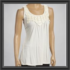 Ivory Rosette Tank Subtly sweet, this tank combines the best of boho styling with dainty accents! From the rosette accented bodice to the feminine scoop neck, this shirt evokes the look of timeless romance in any ensemble! ✨Brand New Still in Packaging✨ Available in sizes Small, Medium & Large. Message me with your size and I'll make a separate listing Simply Irresistible Tops Tank Tops