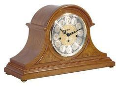 Hermle Amelia Tambour Mantel Clock 21130-i90340-N90340. h1Hermle Amelia Tambour Mantel Clock 21130-i90340-N90340_h1The Hermle Amelia Tambour Mantel Clock 21130-i90340-N90340 comes with brass feet, raised burl veneer panels and a beaded molding across the bottom. Brass 8 day ke.. . See More Mantel Clocks at http://www.ourgreatshop.com/Mantel-Clocks-C1124.aspx