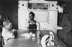 Family at lunch, Wheatlands Plots, Randfontein, September 1962 | David GOLDBLATT | NGV