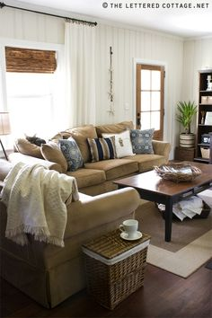 Pretty living room in neutrals and navy.  I like the idea of that color combo. via The Lettered Cottage.