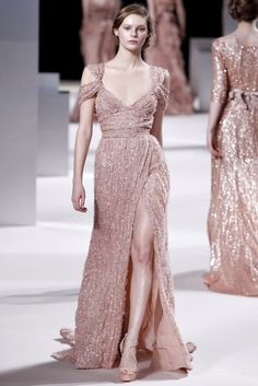 Elie Saab's collections embody feminine beauty,    with delicate lace and embroidery, tons of chiffon, sequin and silk.    Soft colours for Spring, thigh high cuts and bustier tops.    Each dress is overwhelmingly beautiful.