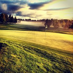 Spruce Run golf course in Traverse City Michigan with morning mist.